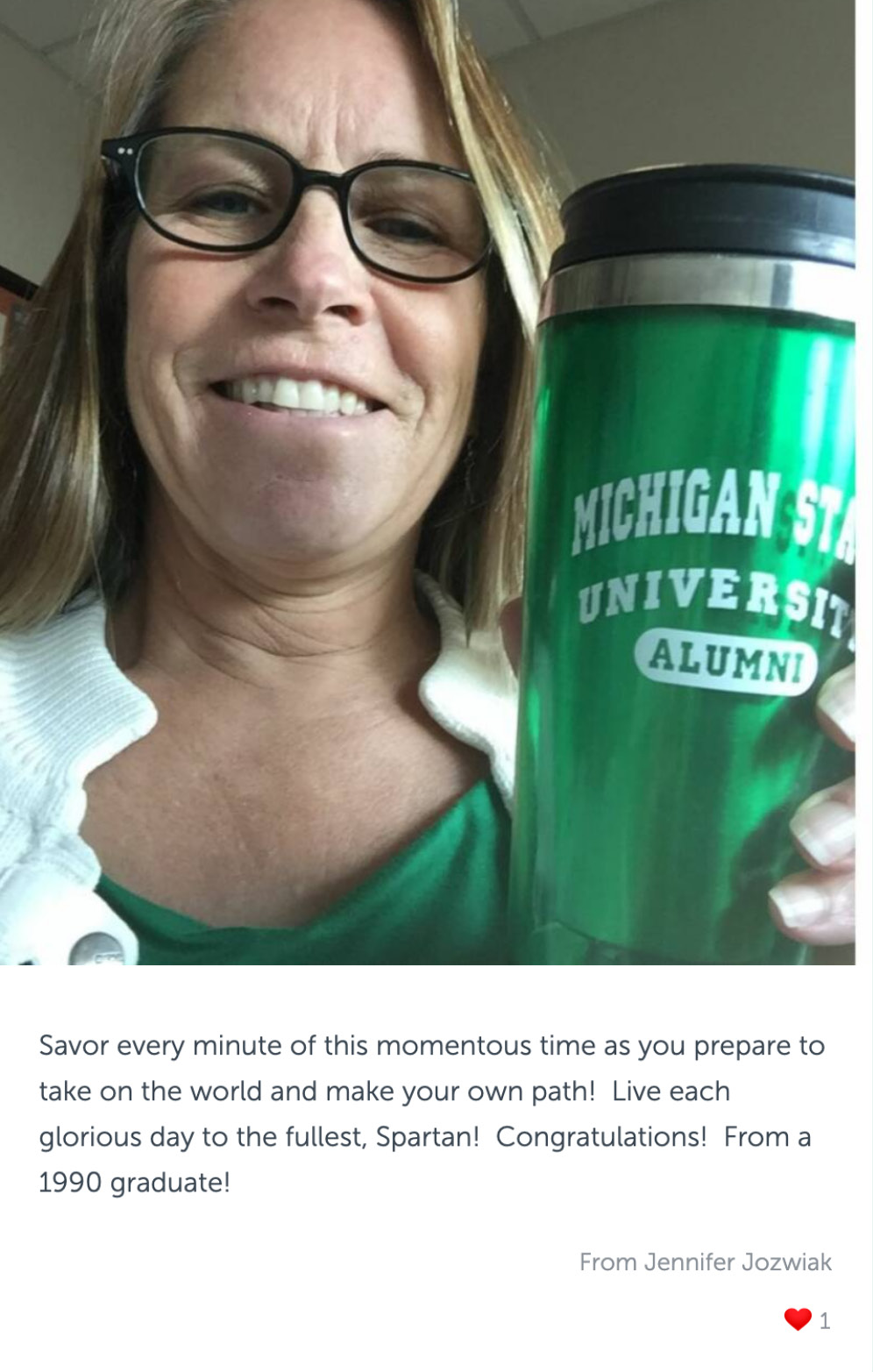 """Post with photo of a woman holding cup that reads """"Michigan State University Alumni"""", and congratulatory message"""