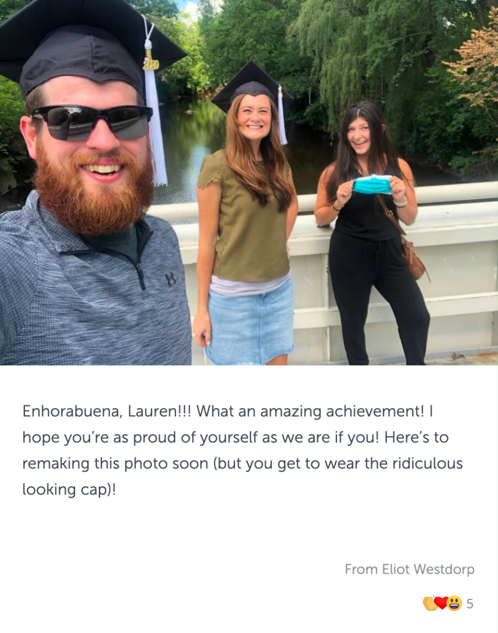 Post with photo of three graduates on a bridge over the red cedar, and congratulatory message